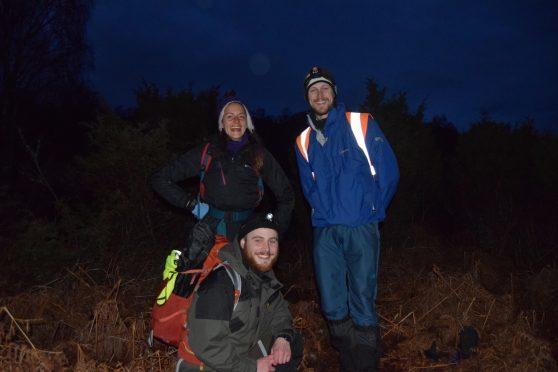 Pictured (L-R): Volunteer wolf pack Dora Clouttick, James Robertson and Matt McMullen at Dundreggan Conservation Estate