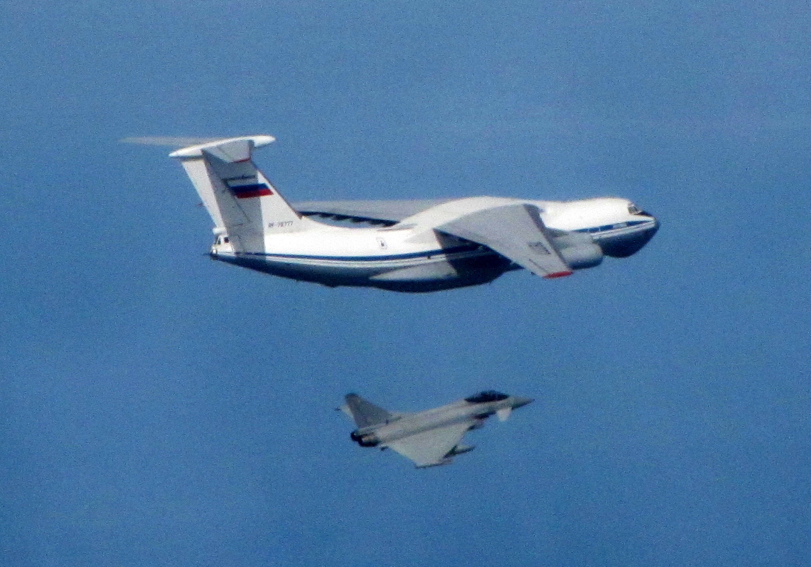 Russian IL76 Candid aircraft, being shadowed by a RAF Typhoon (bottom).