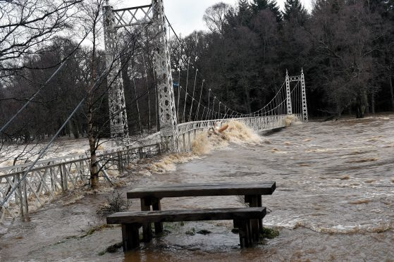 Ballater flooding - the Cambus o May bridge is badly damaged in the flood.