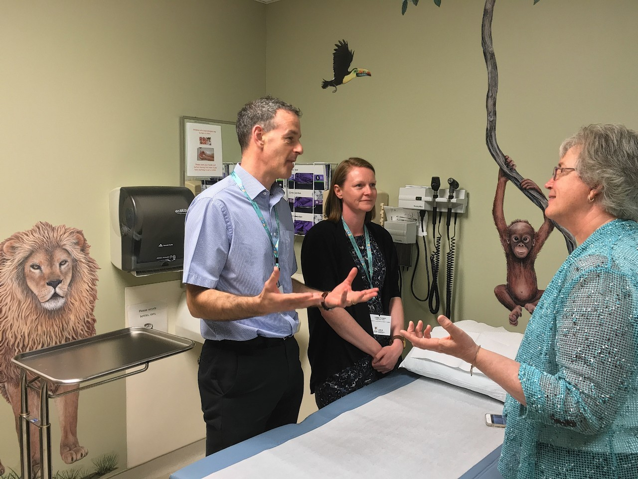 Dr Steve Turner and Senior Charge Nurse Lindsay Cameron discussing patient care in the oncology unit in Children's Hospital Dartmouth-Hitchcock with Sharon Brown from CHaD.