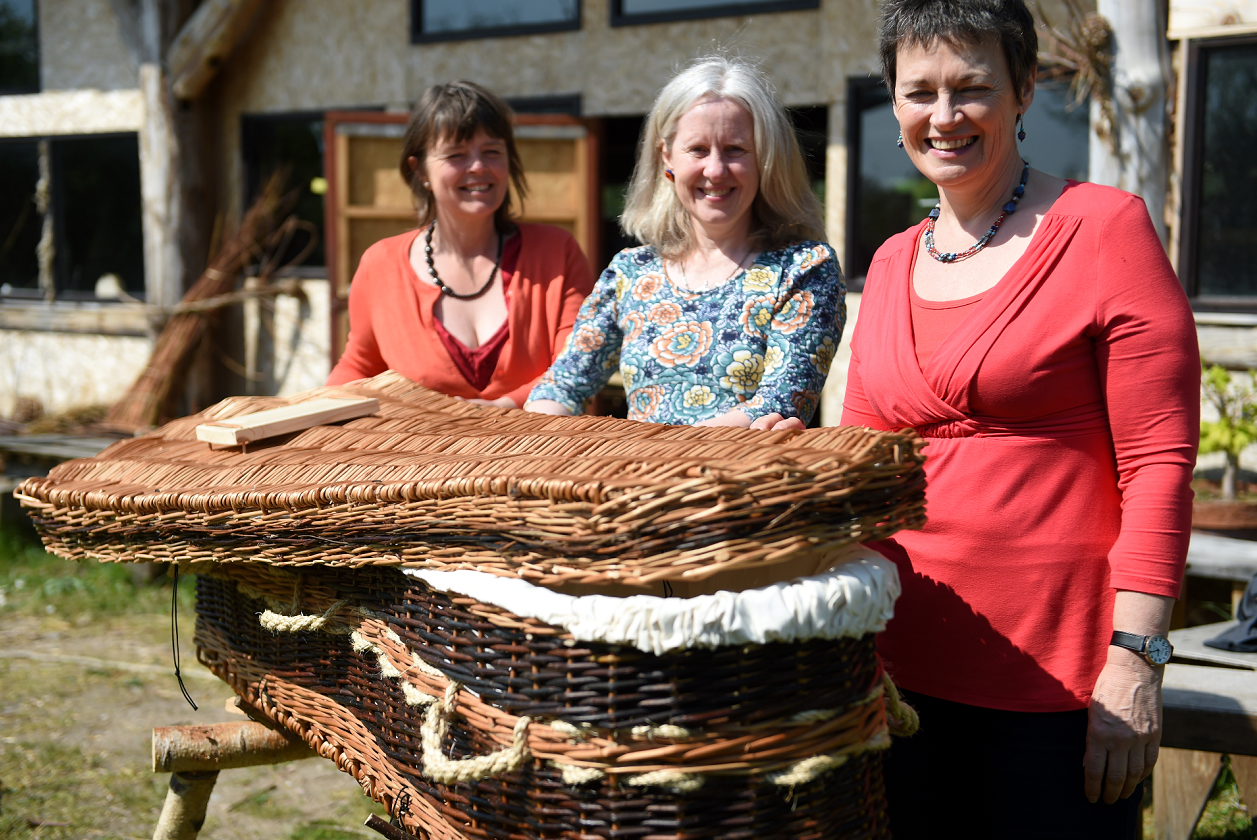 Karen Collins, Kate Clark, and Jane Duncan Rogers with the willow coffin that was on display in the St Giles Centre, Elgin as part of their Dying Awareness campaign.