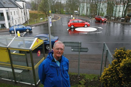 Councillor Allan Henderson at the new mini-roundabout on the A82 in Fort William