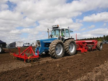 Alister Jessiman of St Fergus puts his 1979 Country 1174 with front mounted leveller, power harrow and drill through its paces