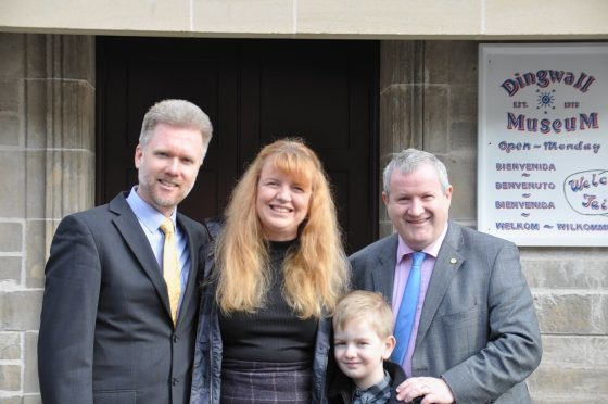 Gregg and Kathryn Brain, with their seven-year-old son Lachlan and Highland MP Ian Blackford
