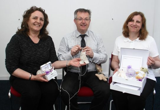 Brendan O'Hara MP with Susan Simpson of SiMBA (right) and Joy Cameron at the event in Oban on Saturday