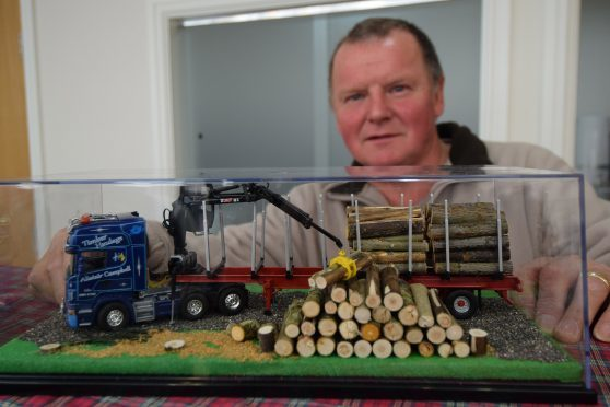 Organiser Robert Wilson with his model of a truck used by local timber haulier Alistair Campbell
