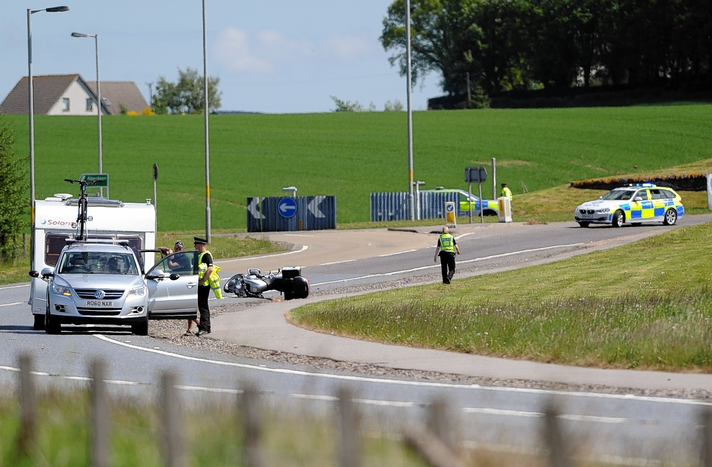 Police a the scene of the crash on the A96