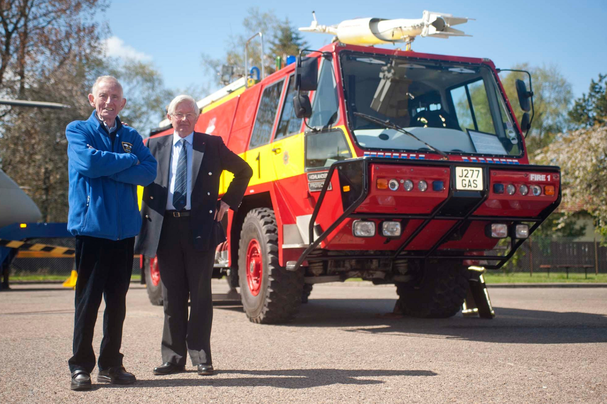 Morayvia in Kinloss has received a Highlander RIV Airport Fire Engine from Highlands and Islands Airports, represented by Grenville Johnston OBE, (right). Morayvia Director, Bob Dennett (left).
