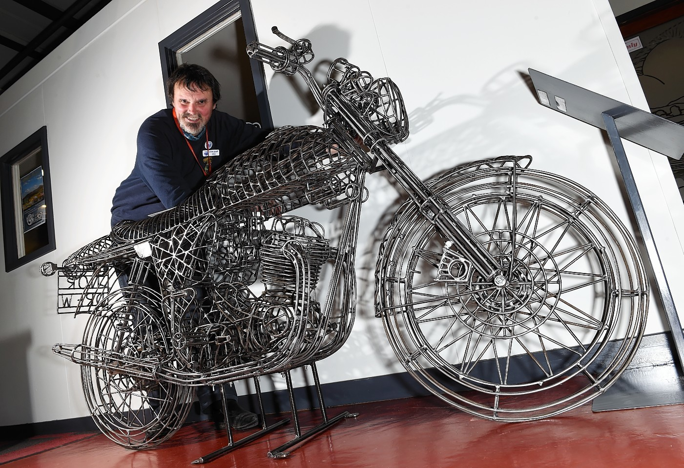 Curator Mike Ward with the sculpture of a Norton Commando Fastback. Picture by Kevin Emslie
