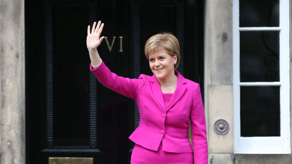 Scottish First Minister and SNP leader Nicola Sturgeon waves from the steps of Bute House in Edinburgh