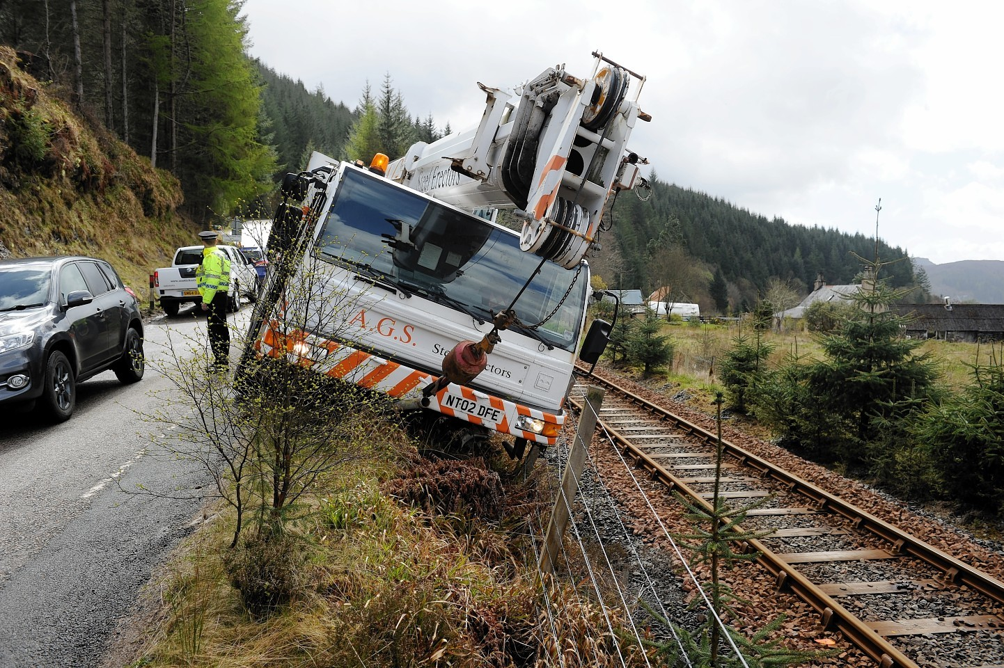 The damaged crane landed on the Inverness to Kyle of Lochalsh railway line