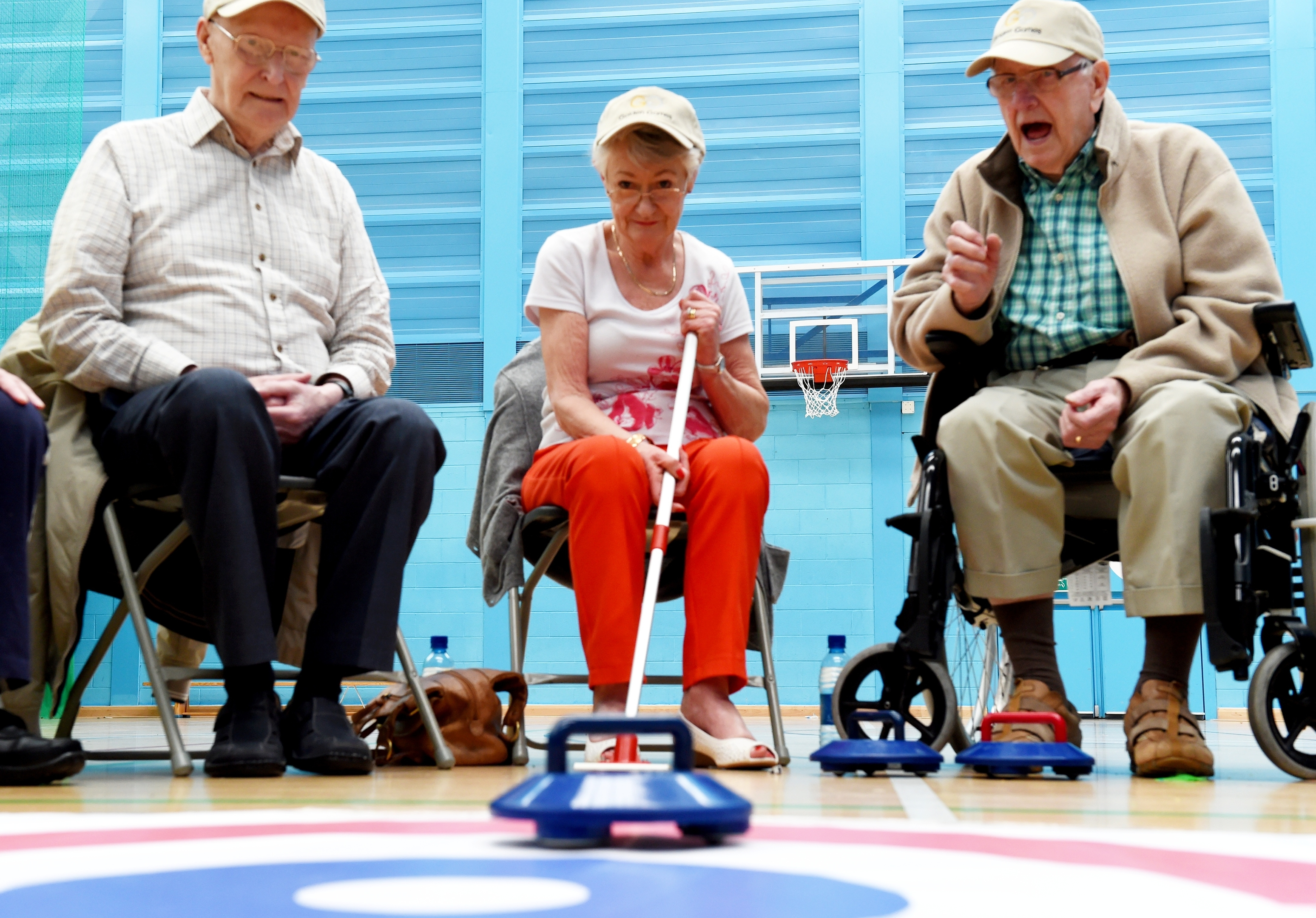 Jimmy Riach, Mary Mitchell and Sandy Courtman compete in the 2016 Golden Games curling. Picture by Colin Rennie