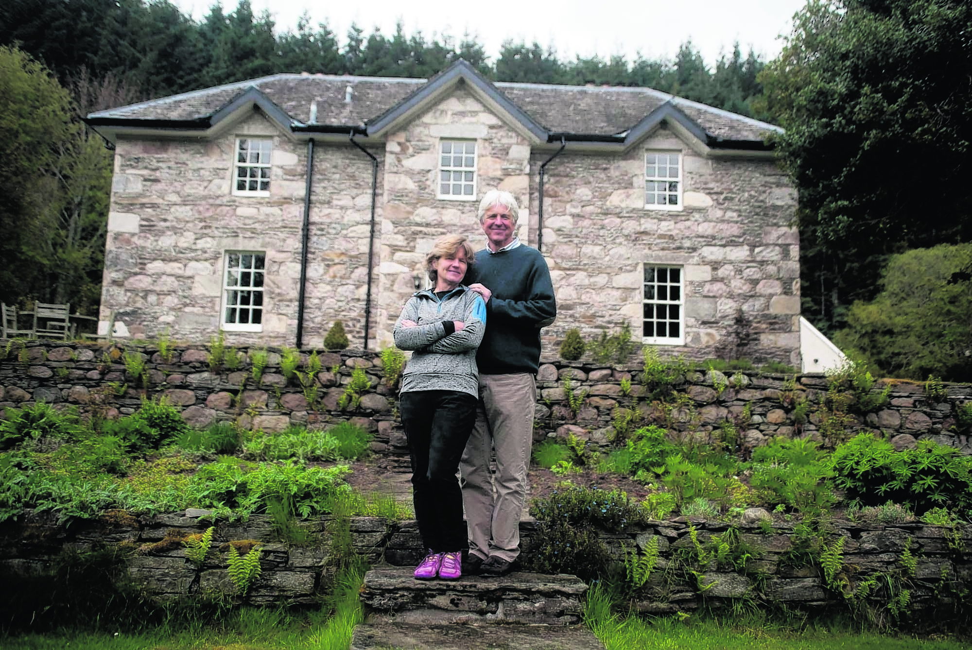 David Anderson  with his wife Bridget and Roly the dog at, Dalvrecht Manse Tomintoul Ballindalloch Moray.