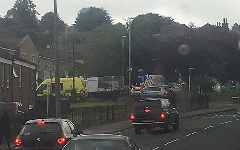 Handout photo taken with permission from the twitter feed of @ScotsFootyCards of police close to the scene in Birstall