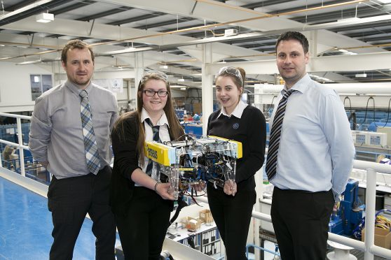 Ali Hynd, principal head of technology for Mintlaw Academy, with Erin Kindness (15) and Joanne McDonald (15) of Mintlaw Academy, and Craig Reid, production manager Hydro Group