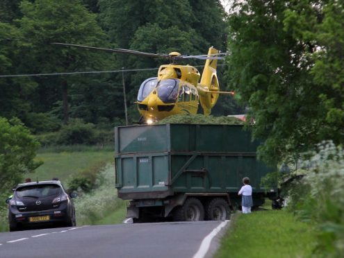 The air ambulance arrives at the scene of the crash.