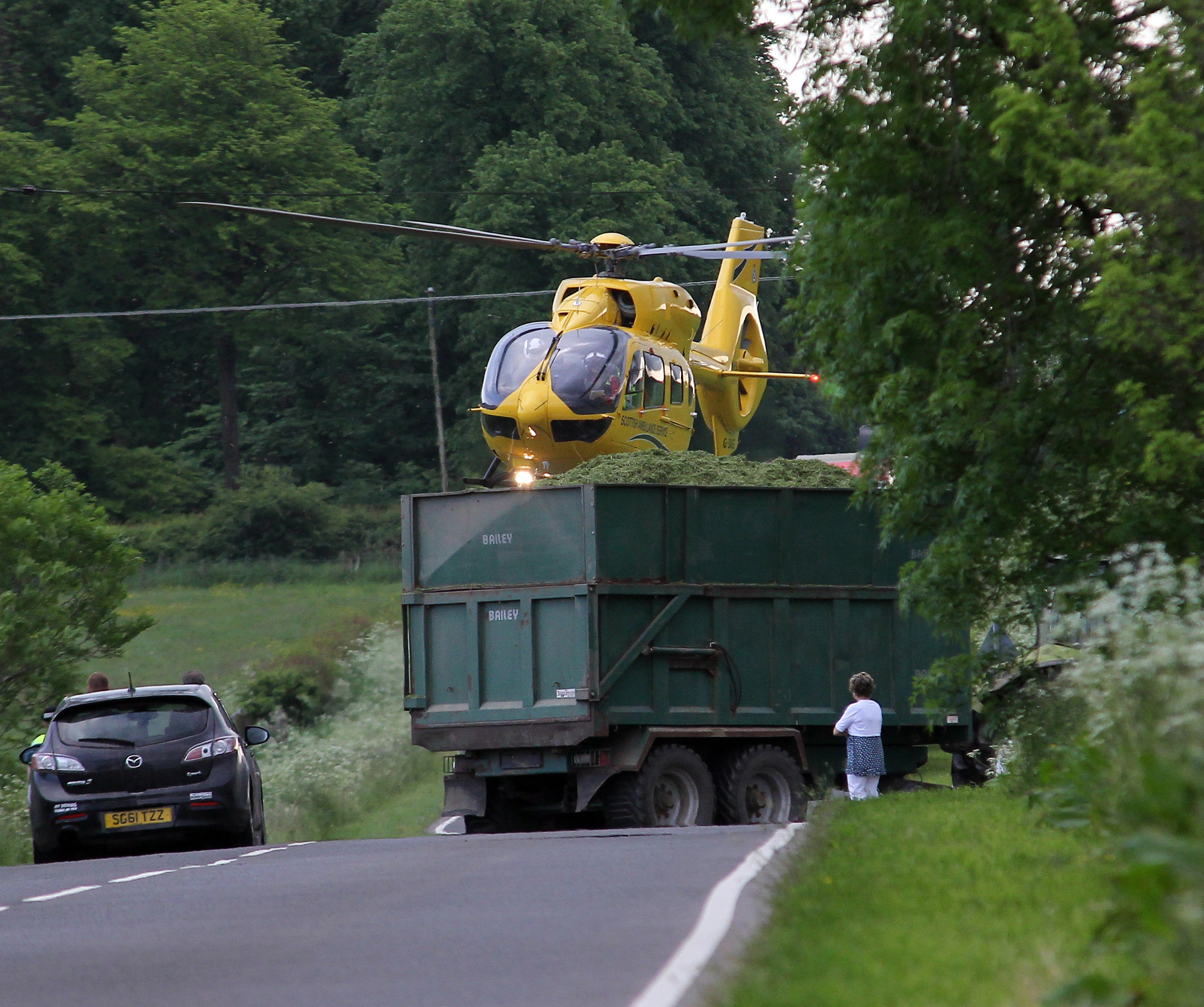 The air ambulance arrives at the scene of the crash