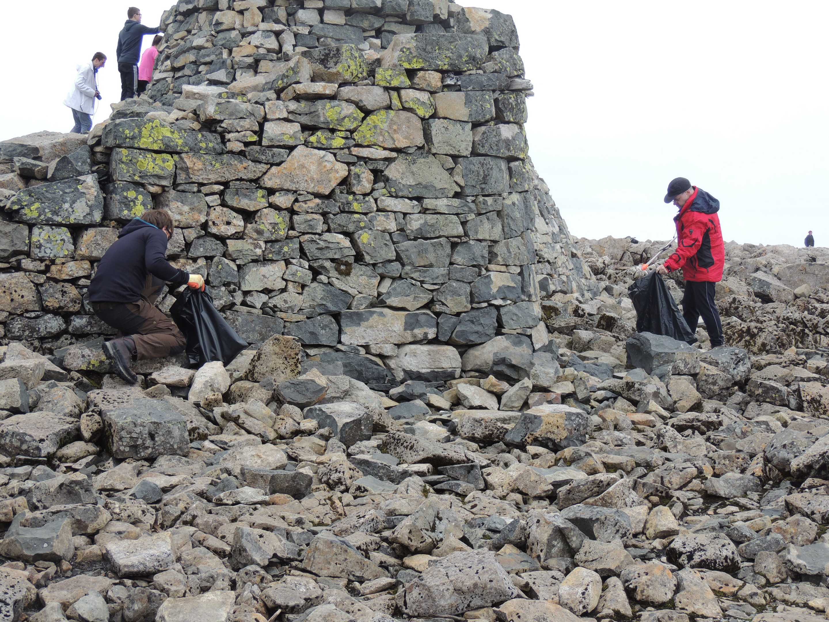 Volunteers collect litter on the summit of Ben Nevis
