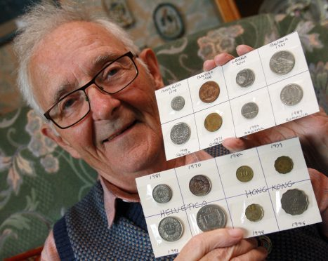 Billy Denney with some of his coin cards