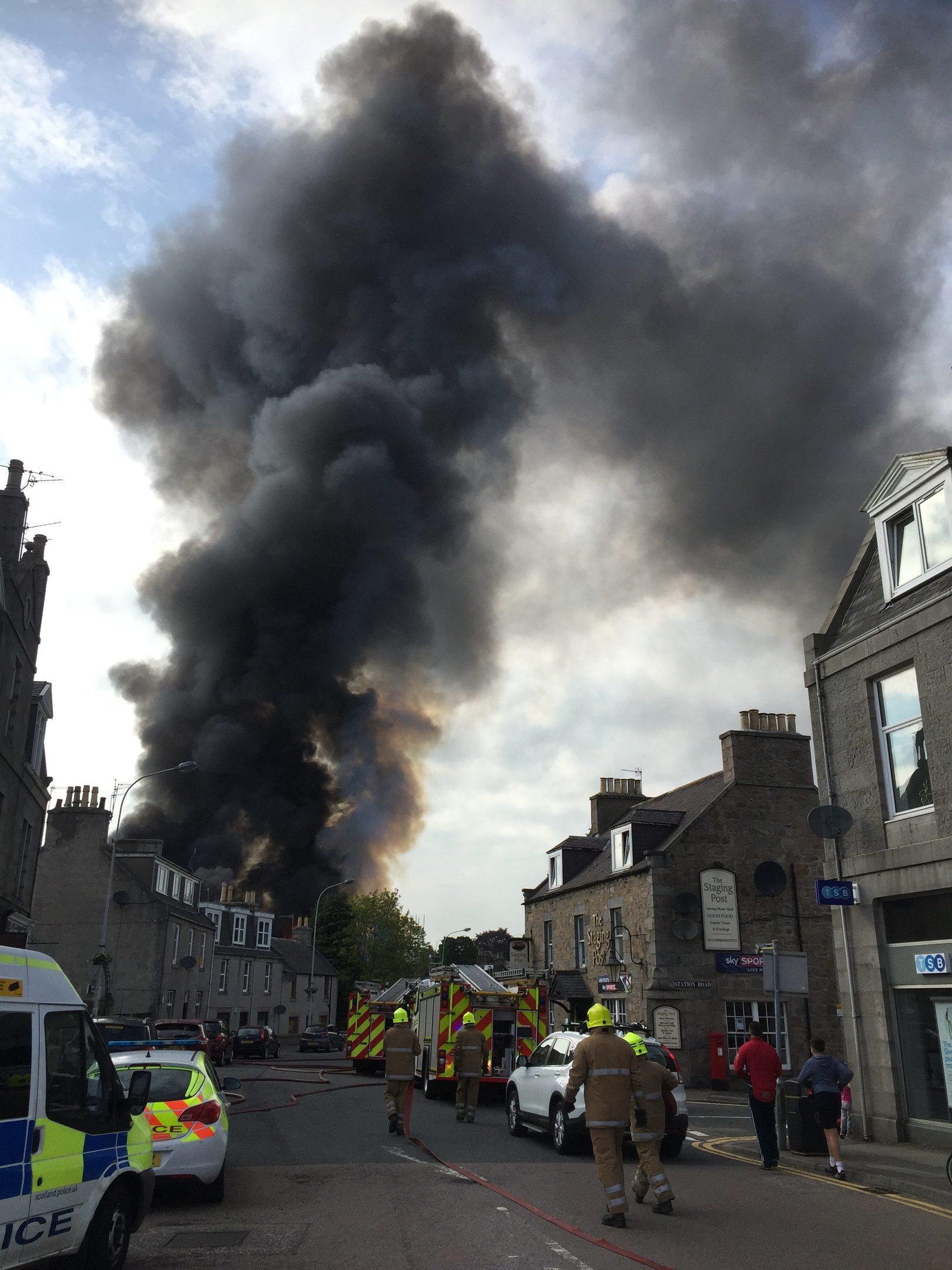 Smoke rises high above the hotel. Joanne Warnock