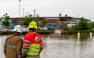 Tesco in Buckie closed its petrol station and operated with a skeleton staff after its car park was flooded.