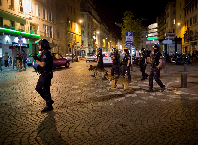Police patrols on a street following scuffles in Marseille, France