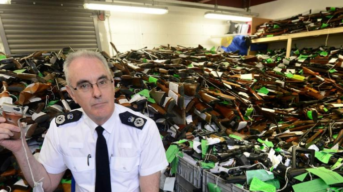 Chief constable Phil Gormley with surrendered weapons. SWNS