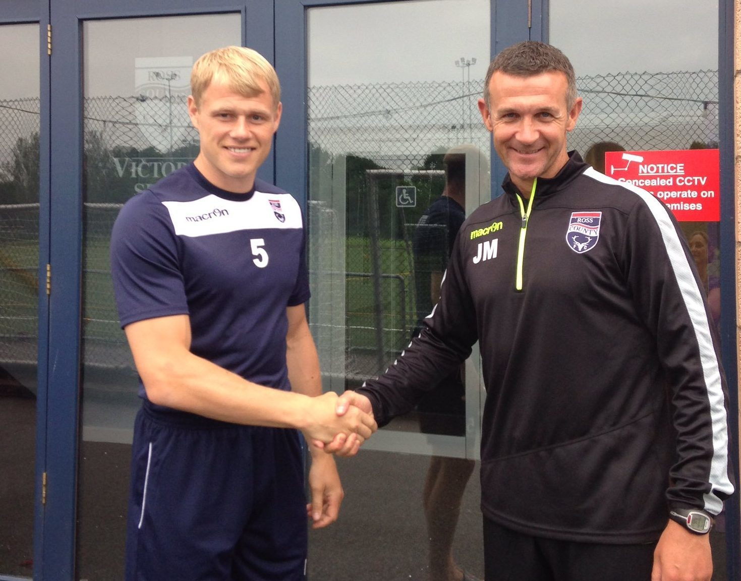 New Ross County signing Jay McEveley with Staggies manager Jim McIntyre.