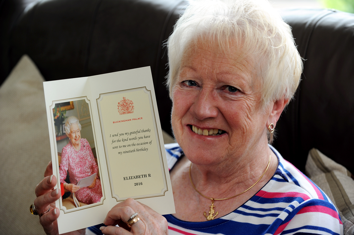 Adeline Reid, chairwoman of the Keith Cancer Link Support Group, with the thank you card she got from the Queen after sending her a 90th birthday card written in Doric. Picture by Gordon Lennox.