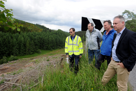 Dave Malpas, Senior Engineer Traffic for Moray Council, Cllr. Mike McConnachie, George Tulloch, secretary of Dufftown and District Community Council, and MSP Richard Lochhead beside the steep drop alongside the B9014, Dufftown to Keith road, which campaigners think should be protected by barriers.