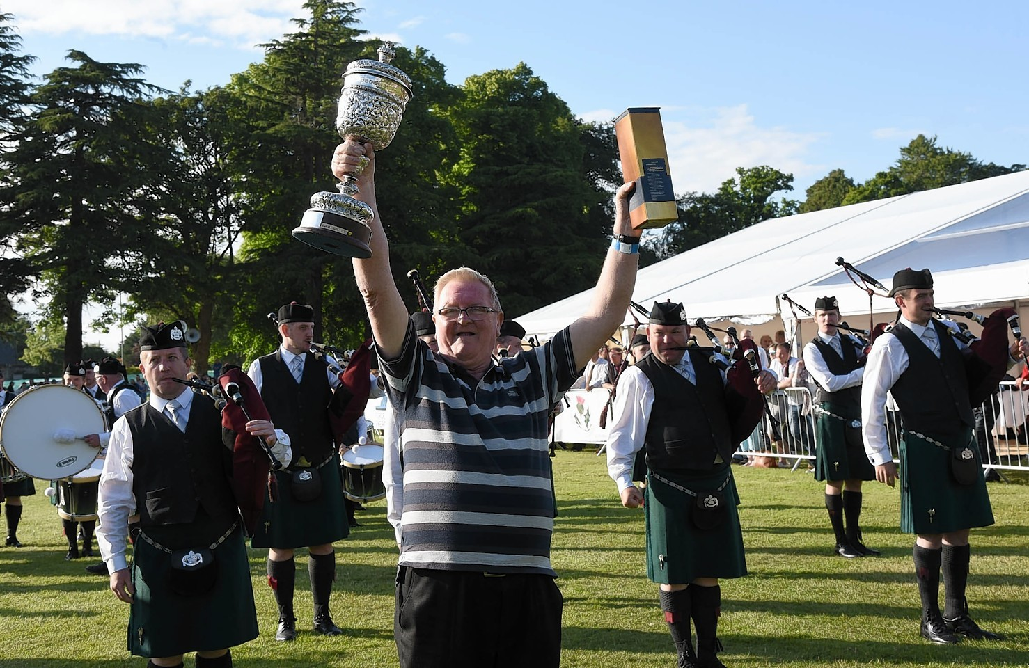 The European Championship trophy is paraded before the St Lawrence O'Toole Pipe Band from Dublin.