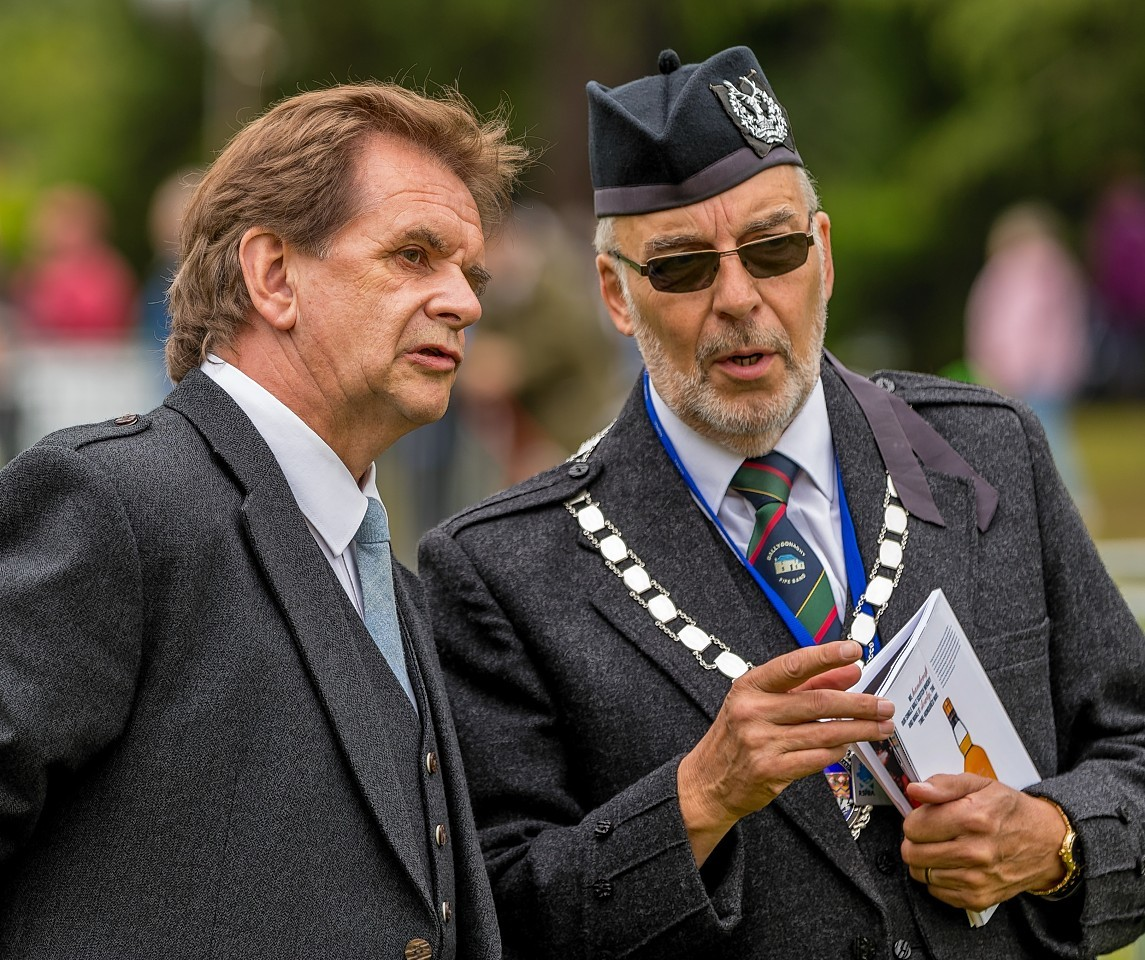 George Ussher (President of Royal Scottish Pipe Band Association with Donnie Munro Chieftain of Piping at Forres.