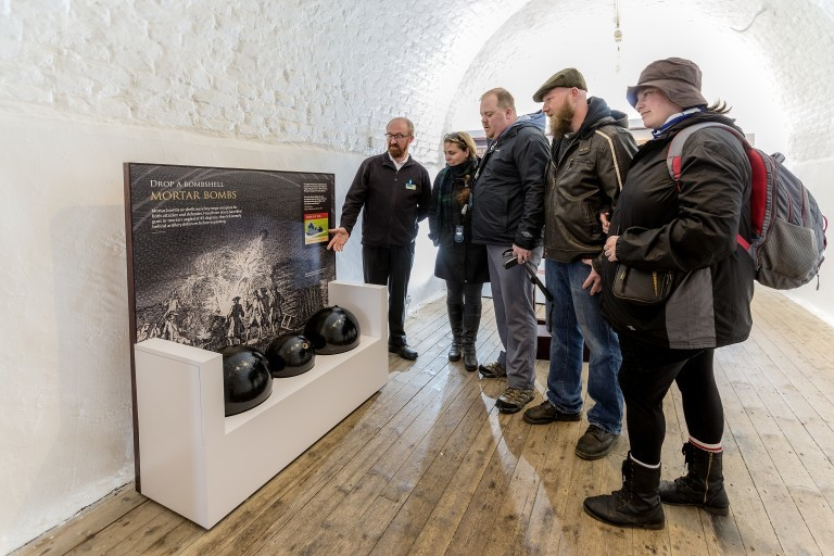 Visitors look at exhibits in Fort George