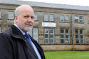 Buckie councillor, Gordon McDonald, at Buckie High School, which is deemed to be not fit for purpose.