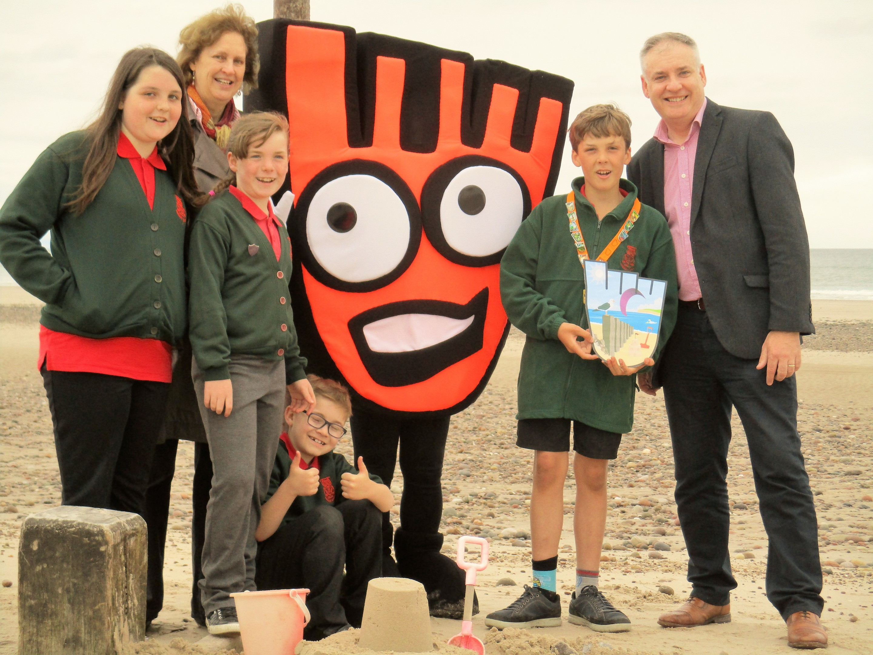 Sam Robbins was joined by classmates from Kinloss School and Moray MSP Richard Lochhead at Findhorn beach, the spot that inspired the drawing.