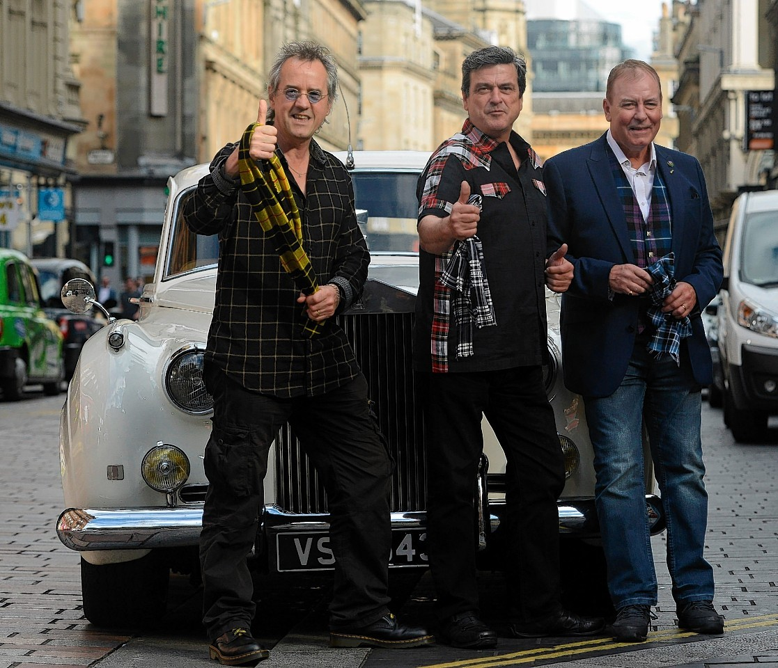 Stuart Wood (Woodie), Les McKeown, and Alan Longmuir, three members of the Bay City Rollers,