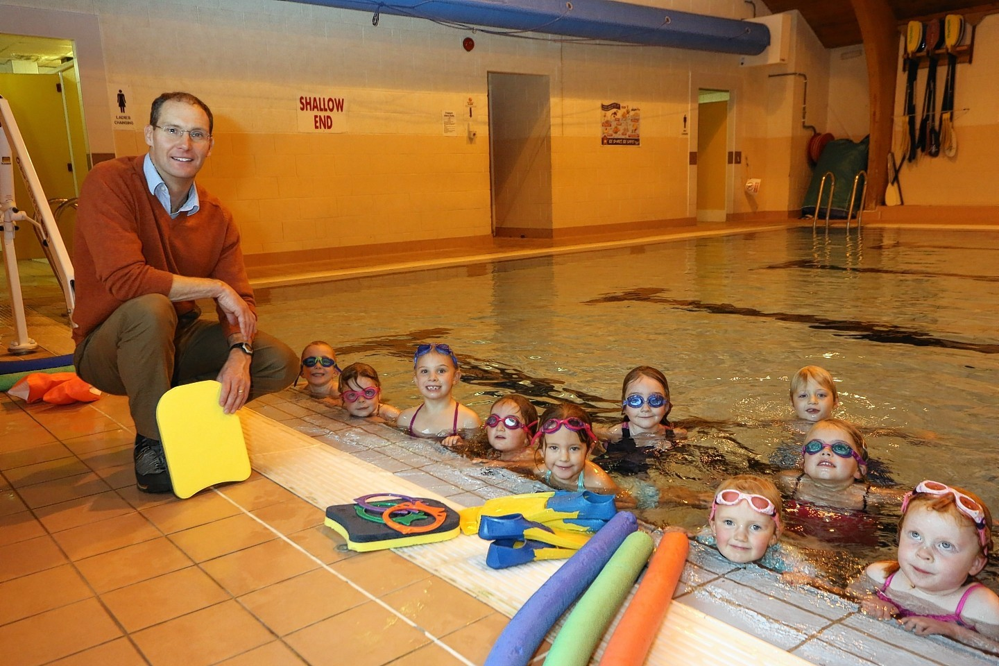 Pool manager Brian O'Rourke with children taking part in a swimming lesson at Mallaig swimming pool