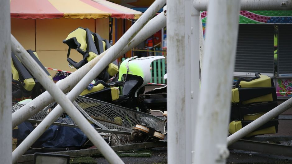 Mangled wreckage at the amusement park in Motherwell, near Glasgow, after the Tsunami rollercoaster derailed.