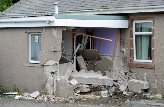 A man has died after the car that he was a passenger in crashed into a house on the A947 North of Turriff at Plaidy.