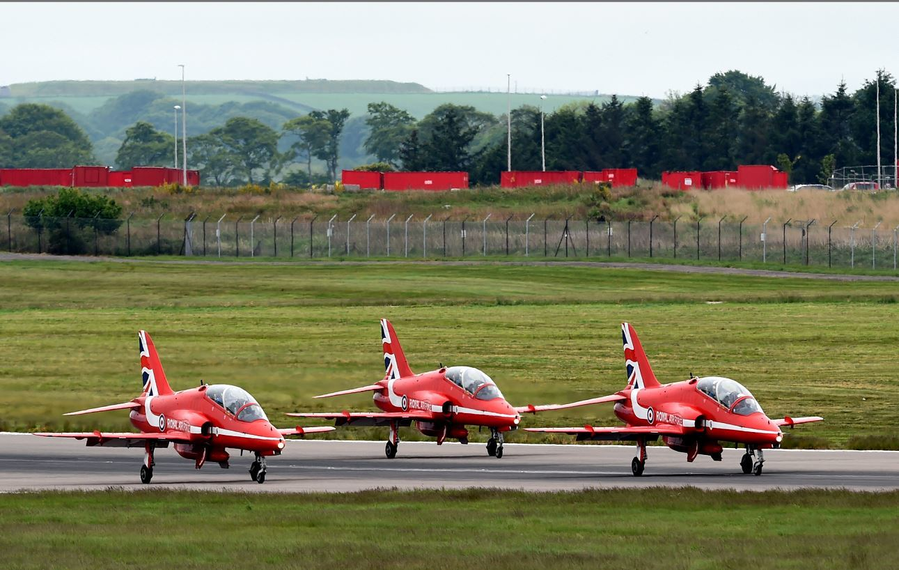 The Royal Air Force Aerobatic Team (RAF), the Red Arrows arriving at Aberdeen Airport. Picture by KENNY ELRICK