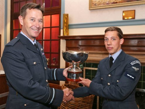 Air Vice-Marshal Gavin Parker, Air Officer Commanding 2 Group presents the McFerran Prize to SAC James Lewis, 51 Squadron RAF Regiment.