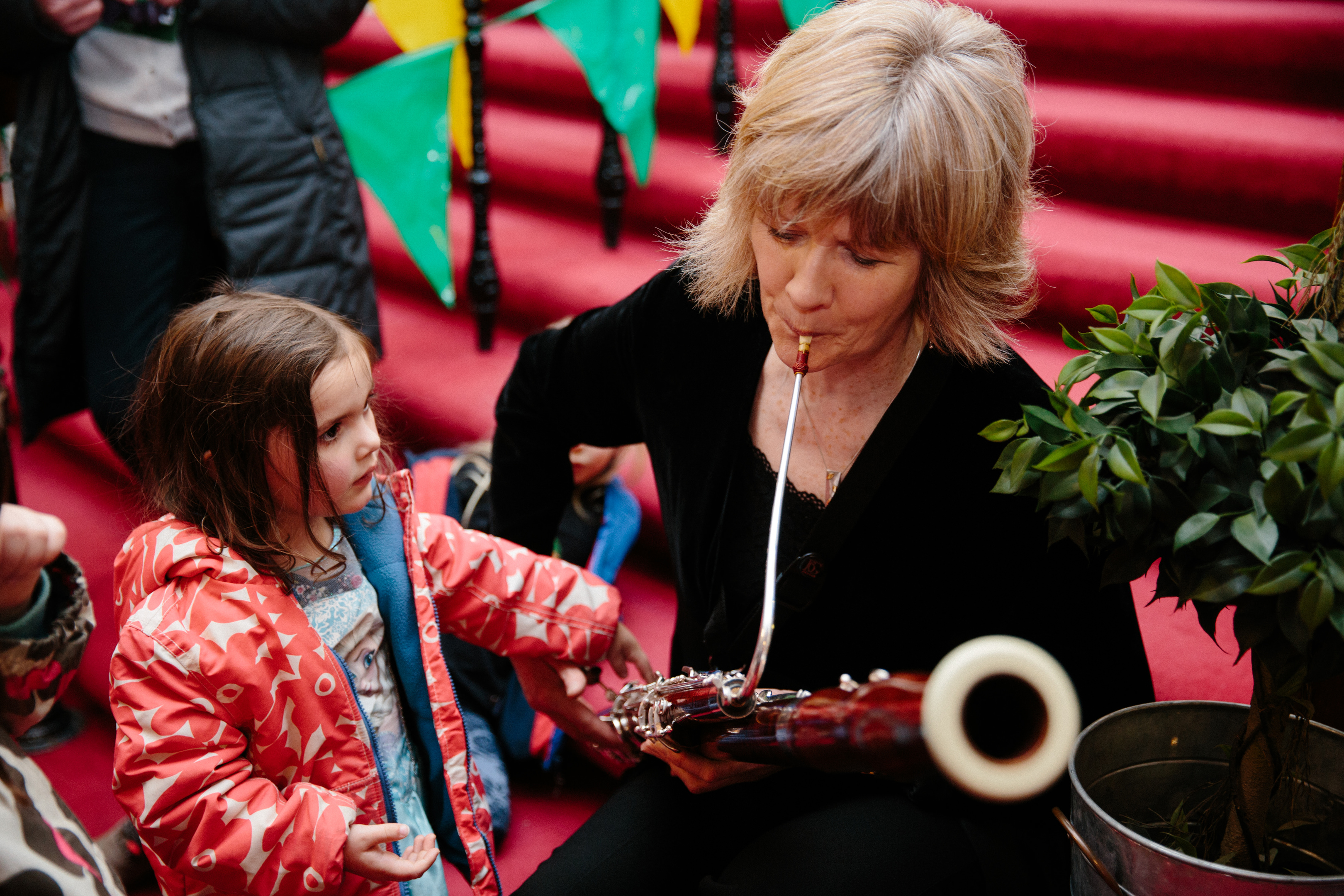 Scottish Chamber Orchestra bassoon player Alison Green shares instrument with youngster at fun day