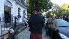 Bagpiper outside Boris Johnson's home