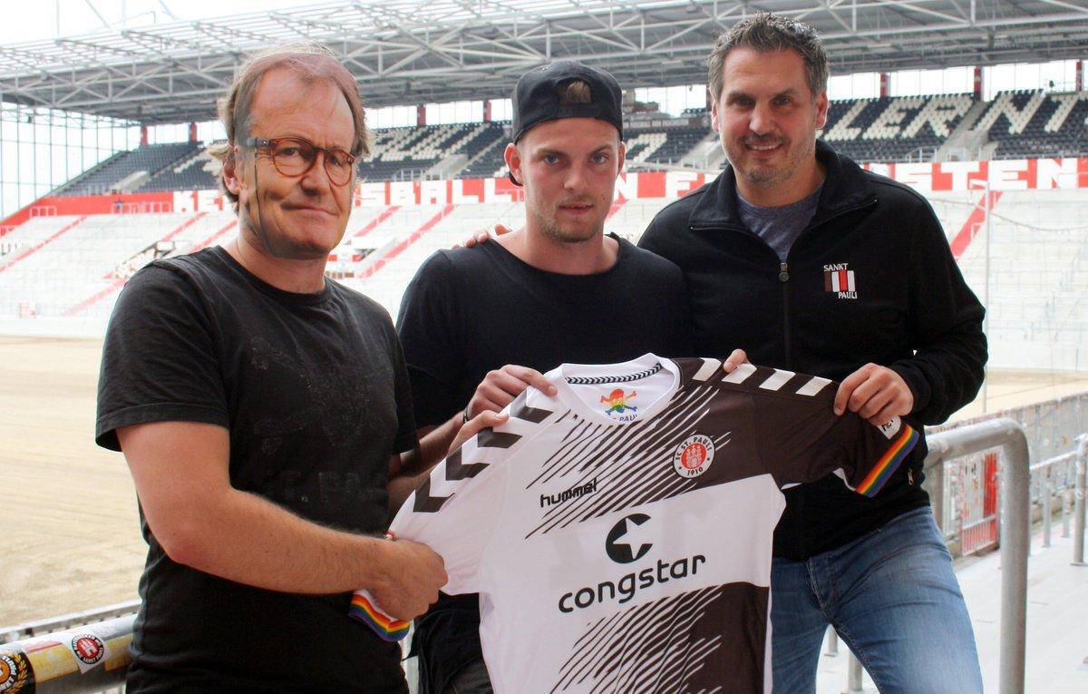 A masked men acting as Ewald Lienen unveiled striker