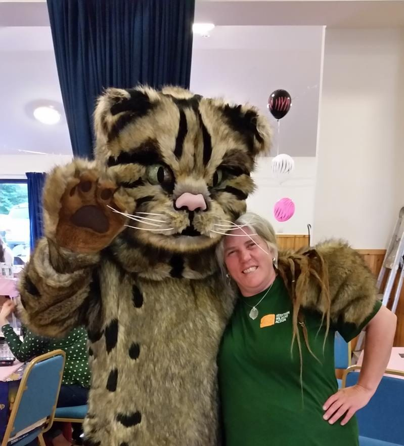 Scottish Wildcat Action (SWA) mascot, William the Wildcat, with Emma Rawling, SWA project officer.