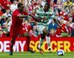 Andre Wisdom challenges Celtic forward Amido Balde