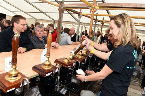 Shelley Paton serving at the inaugral Midsummer Beer Happening in Stonehaven
