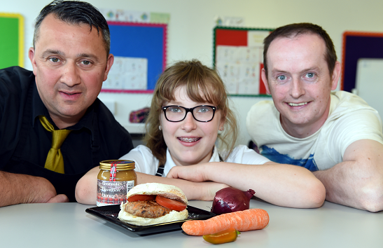 Charlotte Jenkins with her burger and butcher Gavin Brymer (left) and honey producer Ranald McBay (right)