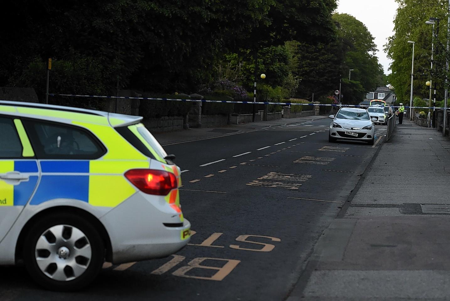 Police at the scene of the crash in Ellon