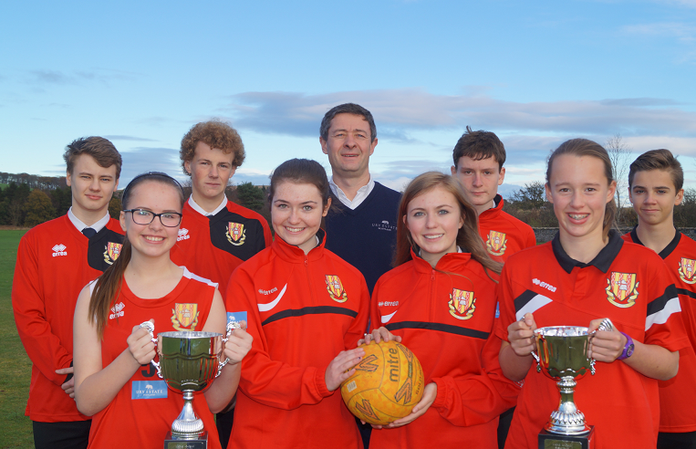Jonathon Milne, director of the FM Group, with Mackie Academy pupils after the firm sponsored the school's new sports kits